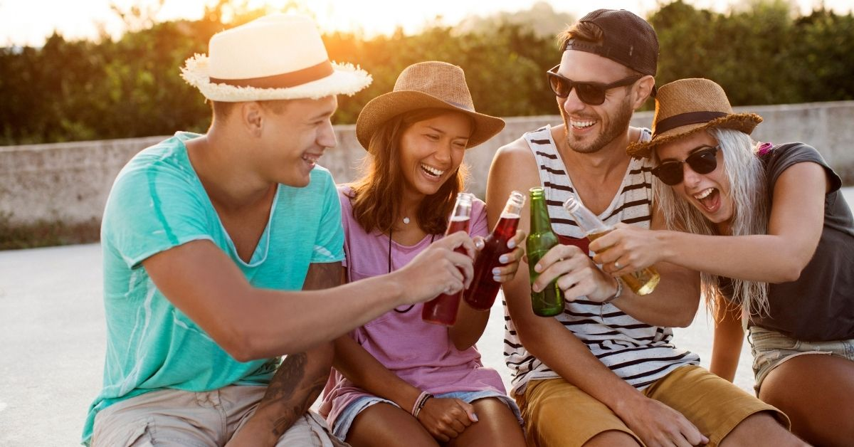 4 friends having beer laughing